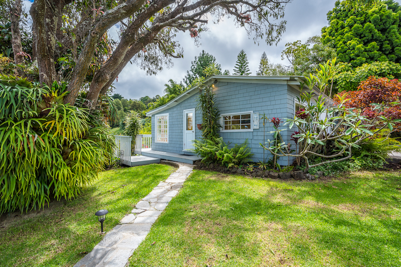 The detached garage of this classic Hawaii Plantation Style Home includes a small office with a half bath